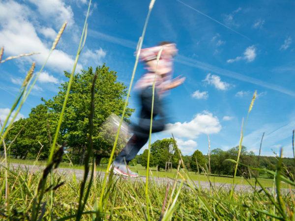 Man Jogging Through Field With Motion Blur